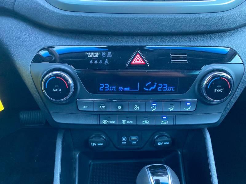 Hyundai Tucson 1.7 CRDi 141 2WD DCT-7 Business Gris occasion à Auch - photo n°19