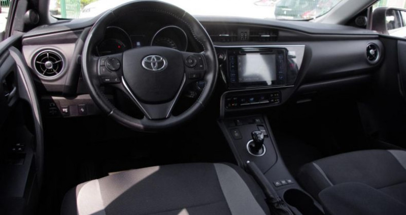 Toyota Auris II (2) HYBRIDE 136H TENDANCE BUSINESS Blanc occasion à Chambourcy - photo n°2